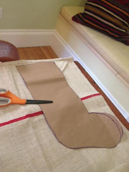 Stocking pattern cut from brown wrapping paper